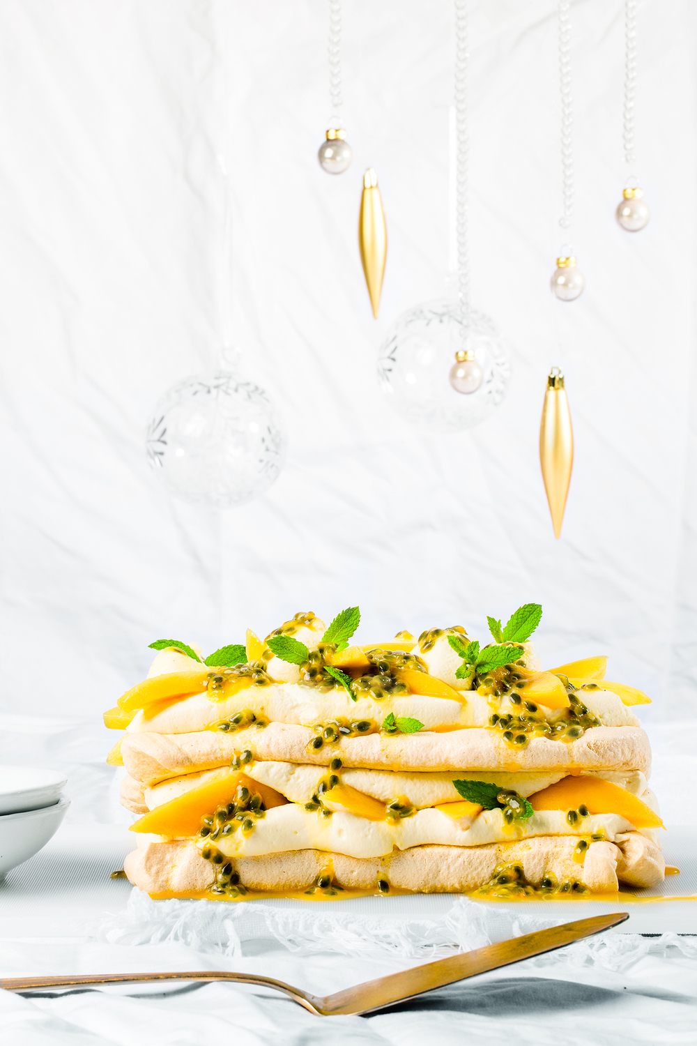 Mango, Passionfruit and Mint Pavlova ,   appeared originally in   Yum. Gluten Free Magazine   Dec Issue.   Recipe and styling by   Cle-ann  , photo by   Hugh Adams  .