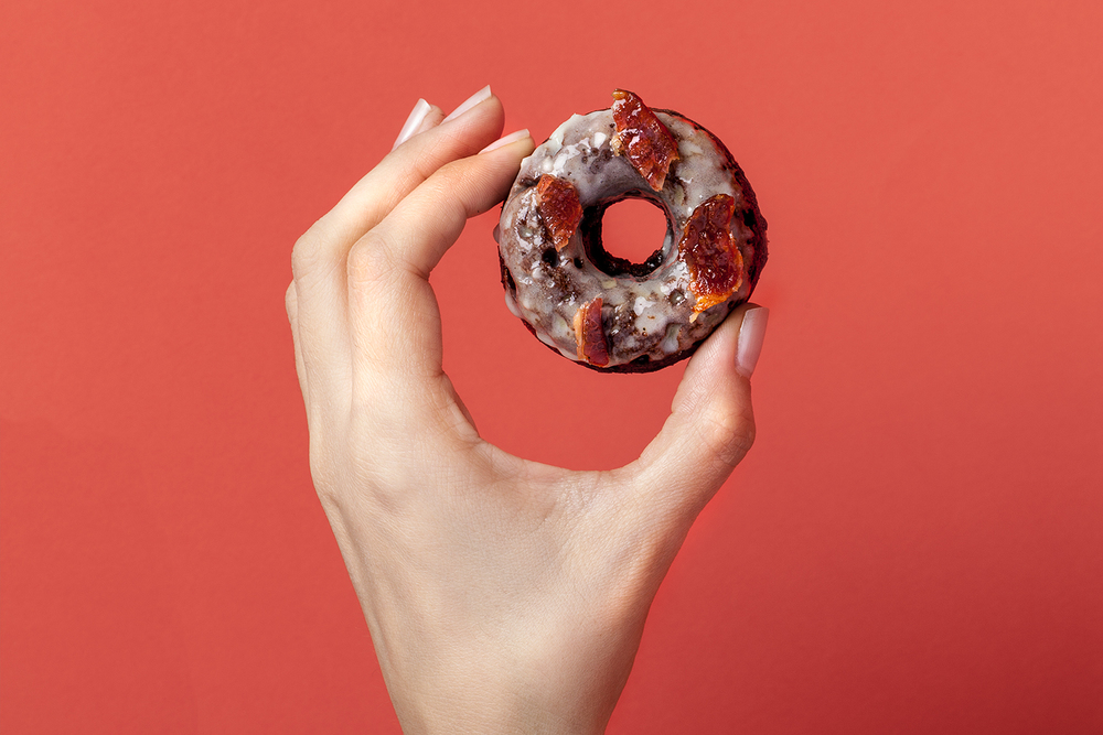 Gluten free baked chocolate doughnut, topped with maple glaze and crispy bacon. Recipe and styling by Cle-ann, photo by Hugh Adams.