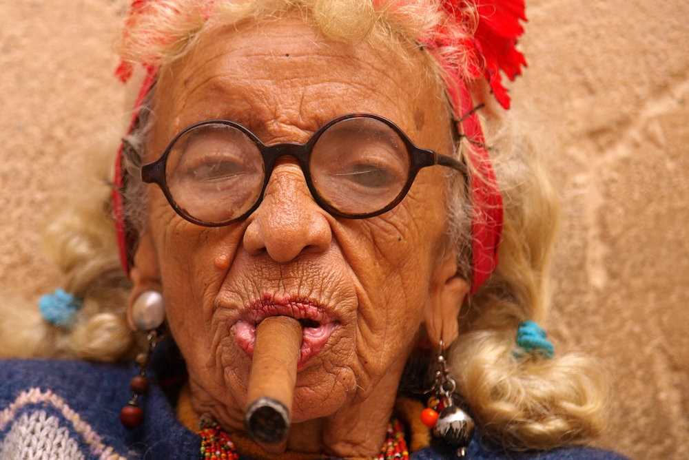 Cigar smoking woman in Cuba  Source: https://commons.wikimedia.org/wiki/File:Cigar_smoking_woman_in_Cuba.jpg