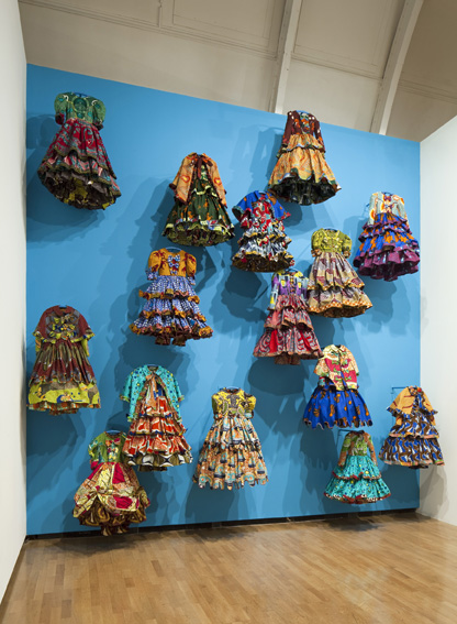19-jan-when-clothes-speak-installation-shot-from-gsk-contemporary-aware-yinka-shonibare-little-rich-girls-2010-1-11758-1.jpg