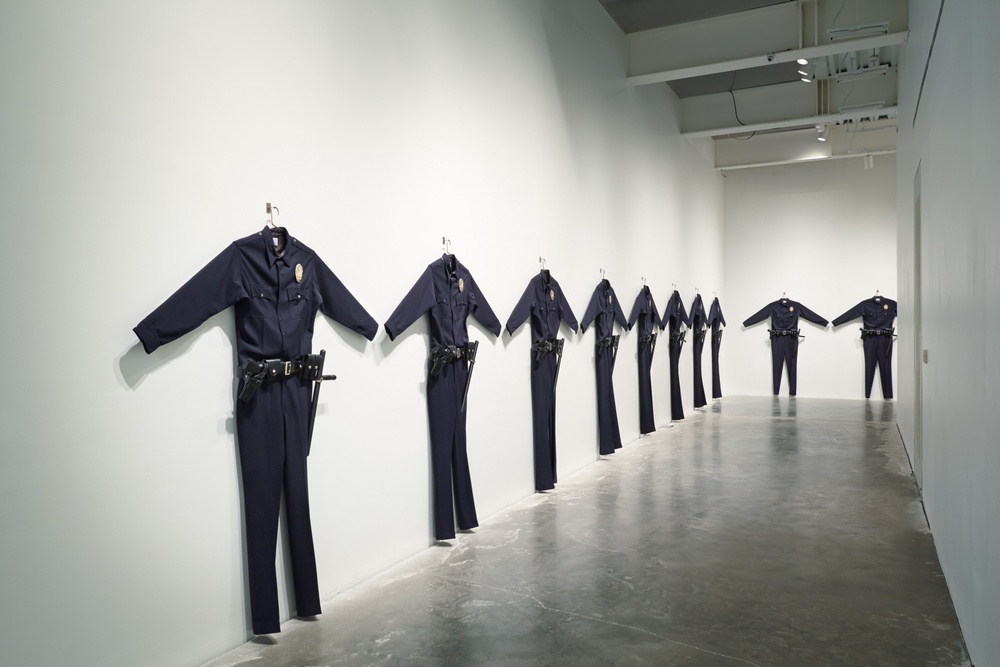 Chris Burden , LAPD Uniforms, 1993.
