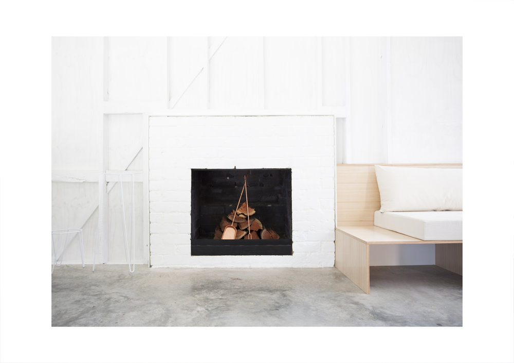 The original red brick open fire place will warm the chilly soul.