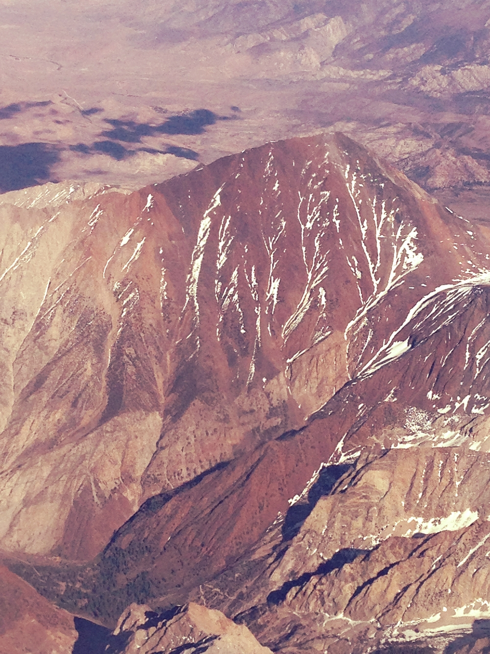 Have you ever wondered what the backside of Mount Tom looked like? Photo by author. Plane, Embraer by United, LAX to Mammoth-Yosemite.