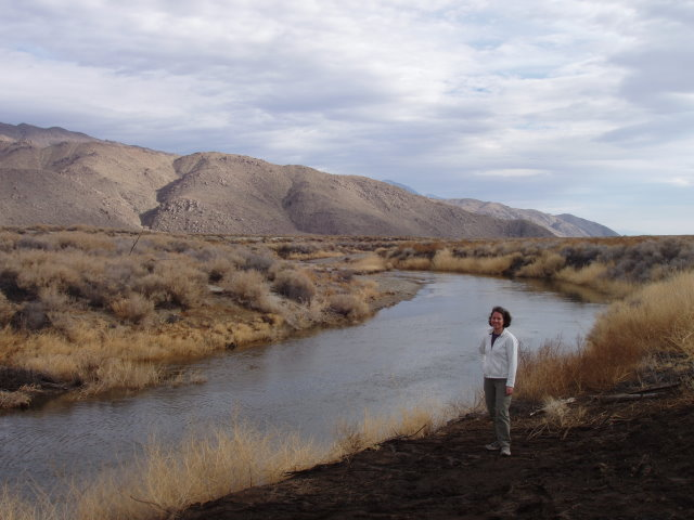 Kristine standing in a prescribed burn area to remove tamarisk along the Owens River