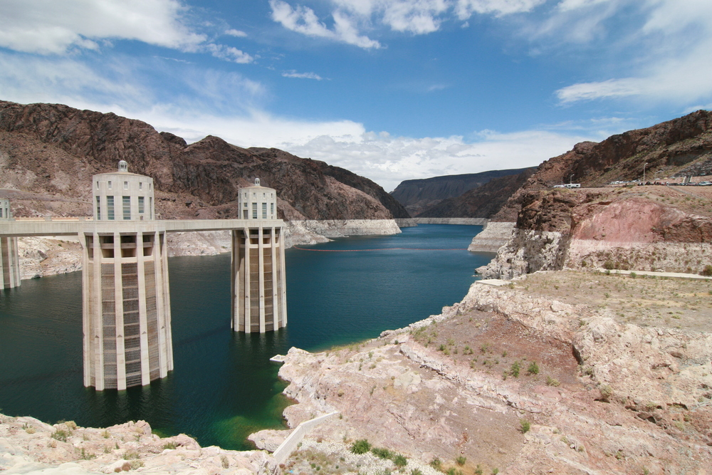 "The ""bathtub ring"" around Lake Mead at Hoover Dam near Henderson, Nevada is a symbol of the devastating drought in the U.S. Southwest. The bathtub ring is white because of the deposition of minerals on previously submerged surfaces."