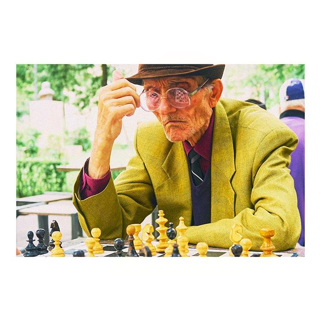 Portrait of a Romanian Man playing Chess in Suit Jacket that doesn't quite fit. Circa 2013 Sibiu Romania
