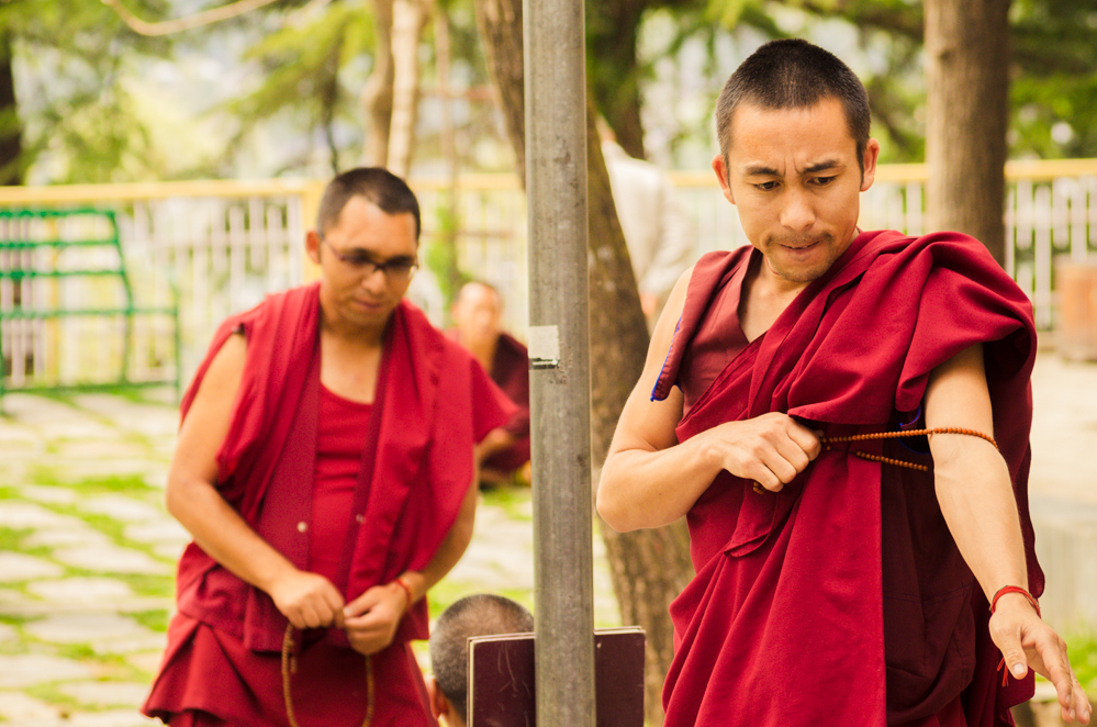 It is common practice for student monks to gather and discuss the nuances of Buddhist thought.