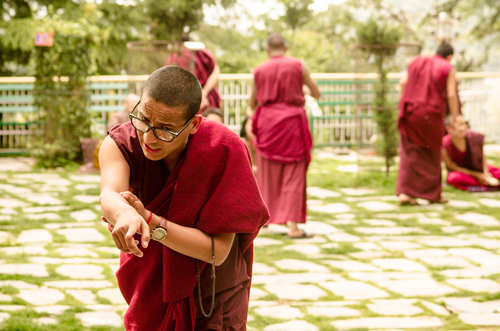 Monks perform a characteristic gesture of clapping their hands and pointing at their opposition when making a point in the discussion.