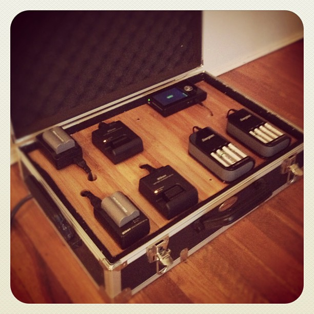 I'm king of the nerds!  My new camera gear charging station.  Complete with bamboo flooring. (Taken with  Instagram )