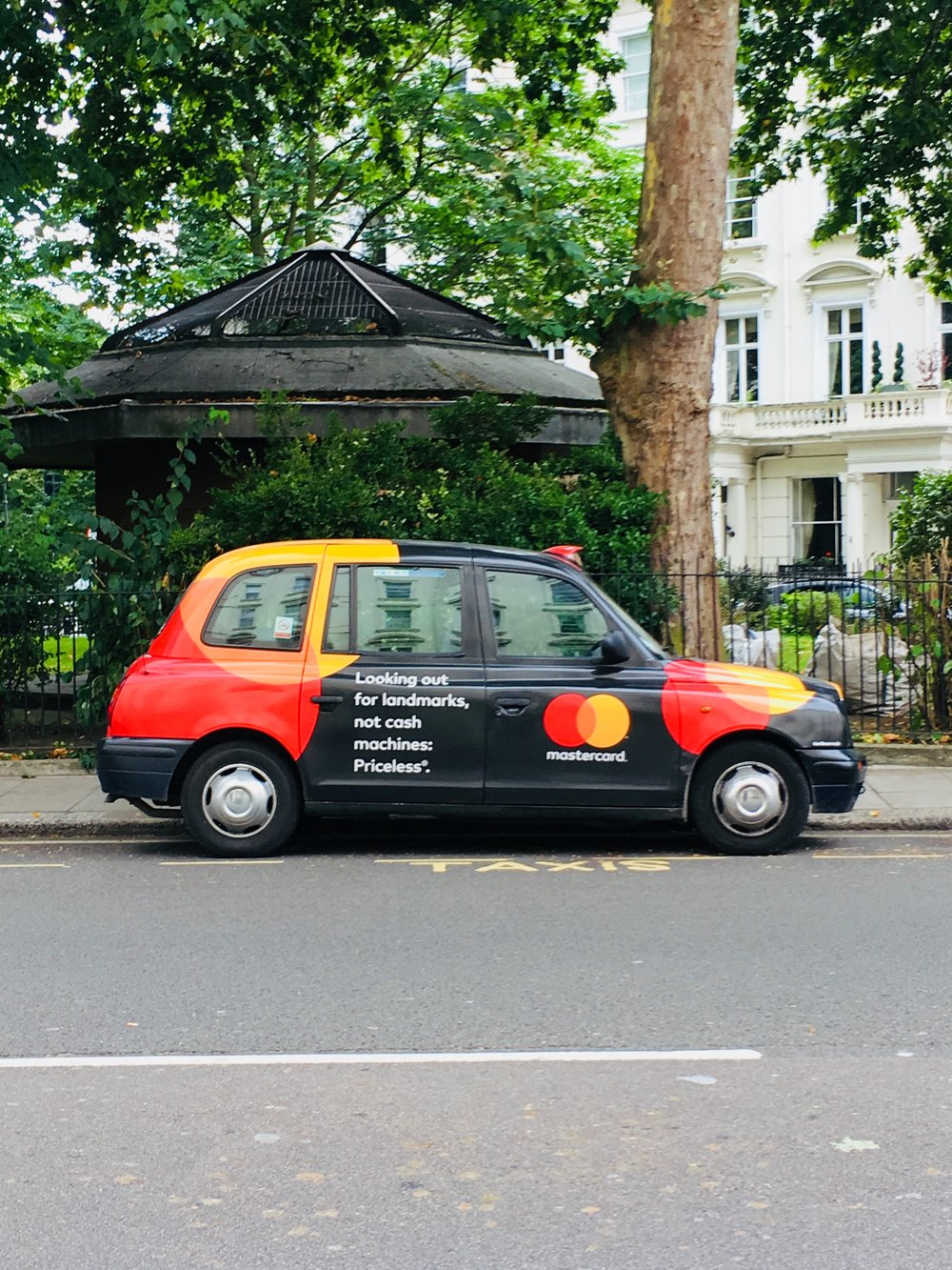 This ad shows off the MasterCard rebrand by Pentegram. The logo is used as a graphic element on different sections of the taxi.