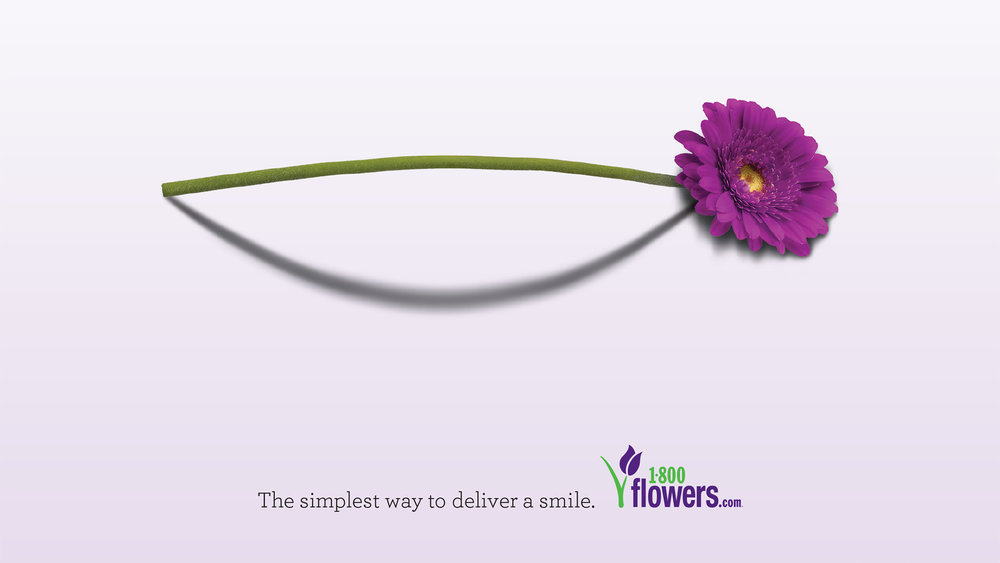 """A minimal ad for a conference program. Copy reads: """"The simplest way to deliver a smile."""""""