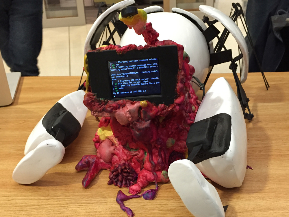The front of the robot housed a screen and microphone, which allowed people to interacted with it via speech. The robot, a wizard-of-oz-device operated by one of our players, responded via text on the screen.