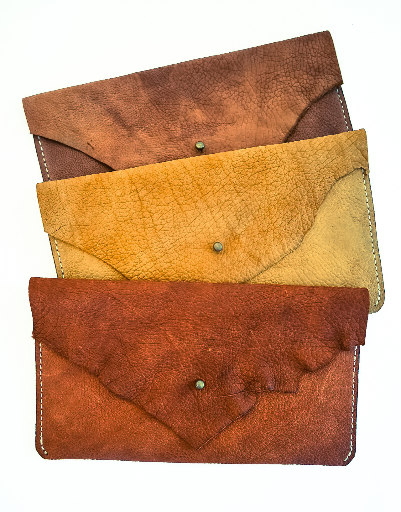Denim lined, raw edge leather pouches   coming soon    www.faitlaforce.com