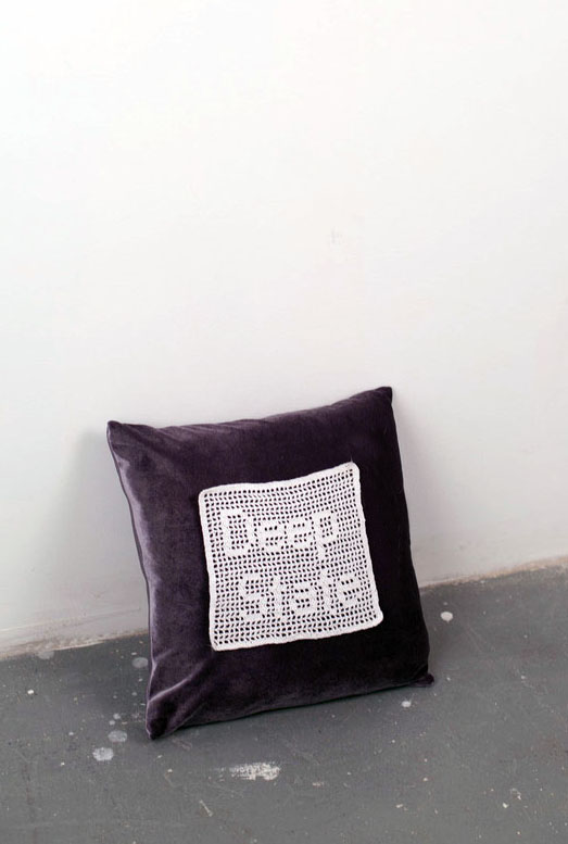 "Deep State, 2014.  Lace crochet on velvet, pillow. 14"" x 14"""