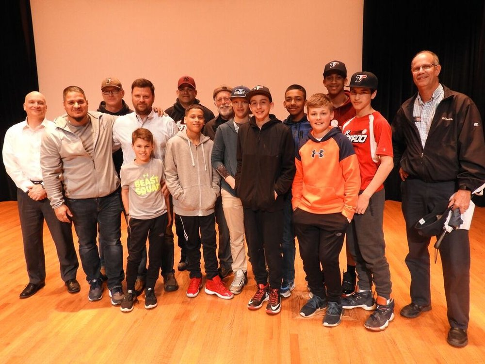 Eugene with players and coaches of Roberto Clemente League