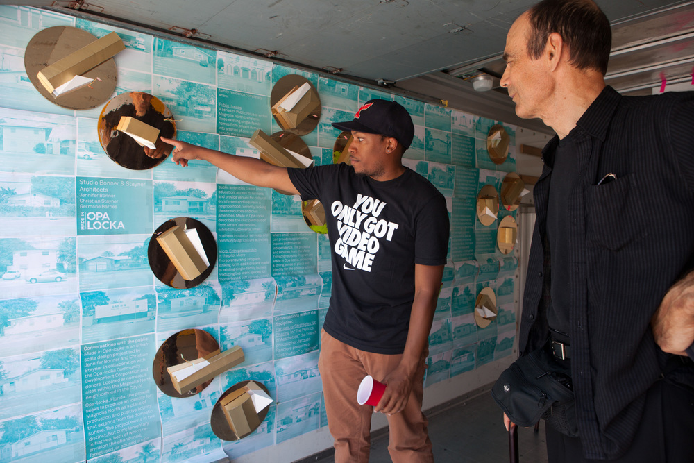 Germane shows Nick Roberts the concept behind Made in Opa-locka.