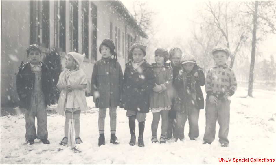 Children in the snow outside the Fifth Street School. Courtesy of http://www.library.unlv.edu/speccol/photo_gallery/las_vegas_history/0003-0020kidssnow(large).jpg