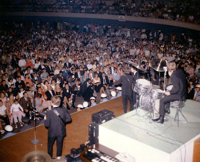 Beatles on stage at the Las Vegas Convention Center -Courtesy of the Las Vegas News Bureau