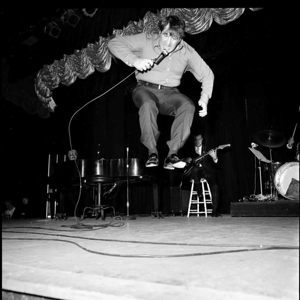 23432-8 Shecky on stage.jpg