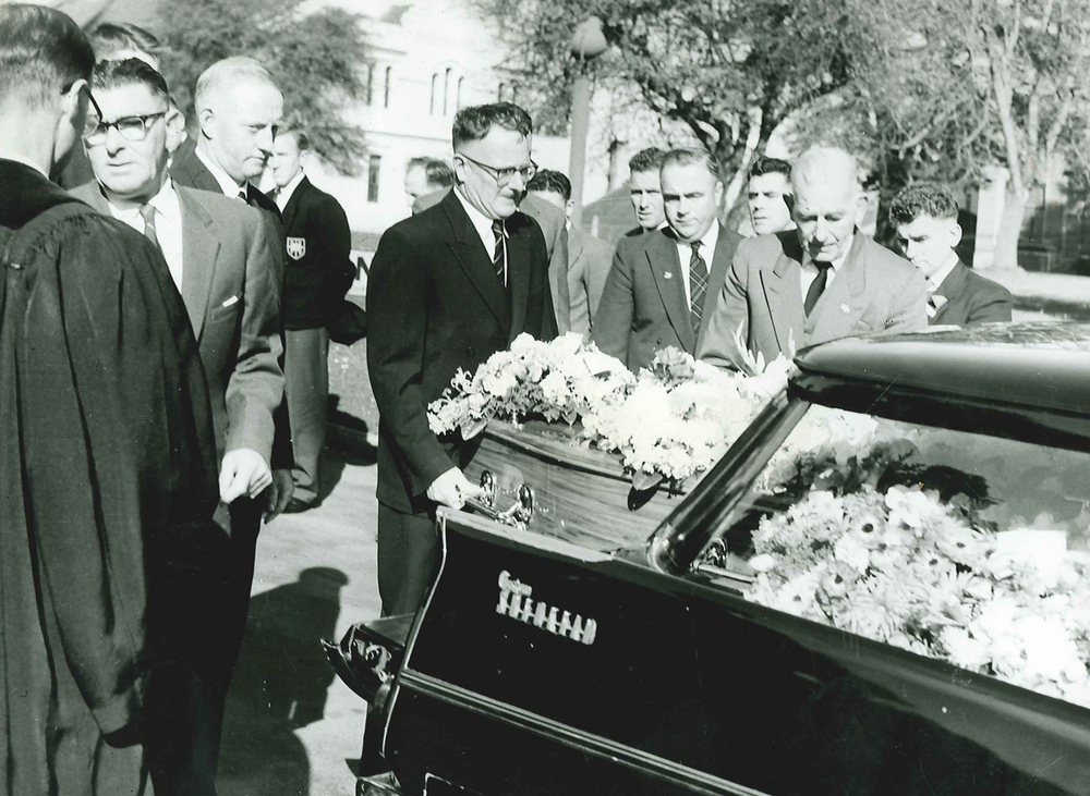 1961 E L Hope with casket of Roy Nieper.jpg