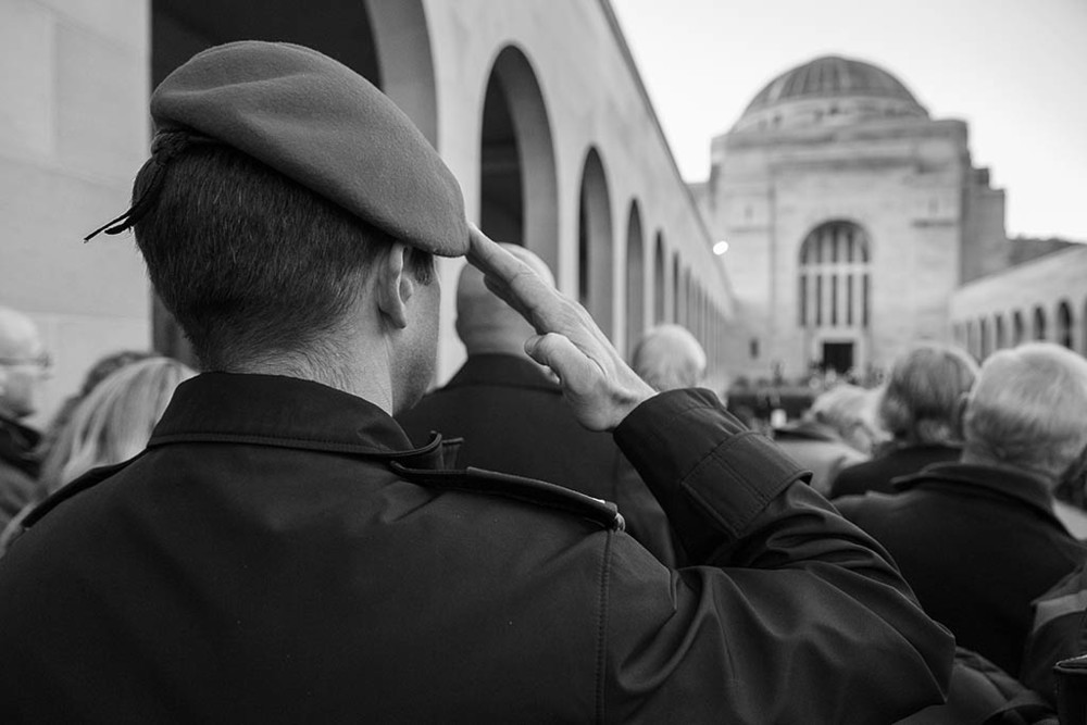 A German soldier salutes during the playing of The Last Post.