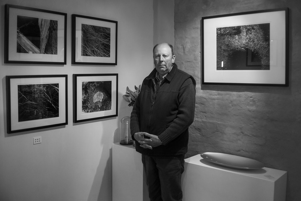 Stephen Hartup amongst his exhibtion at X Gallery.