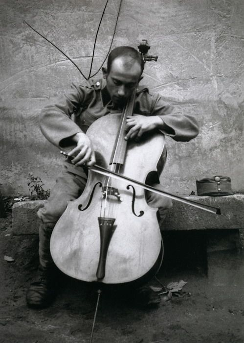 A musician in Esztergom, Hungary (1916) by André Kertész.