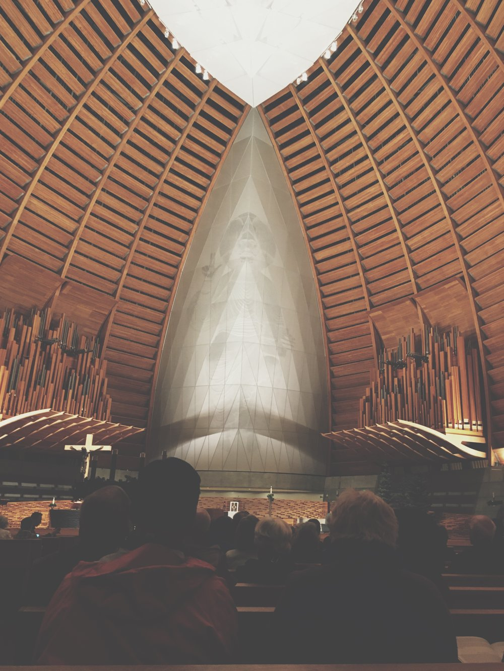 Cathedral of Christ the Light  (Oakland, California) on the evening of Jonathan Dimmock's performance, with organ pipes visible on the left and right.
