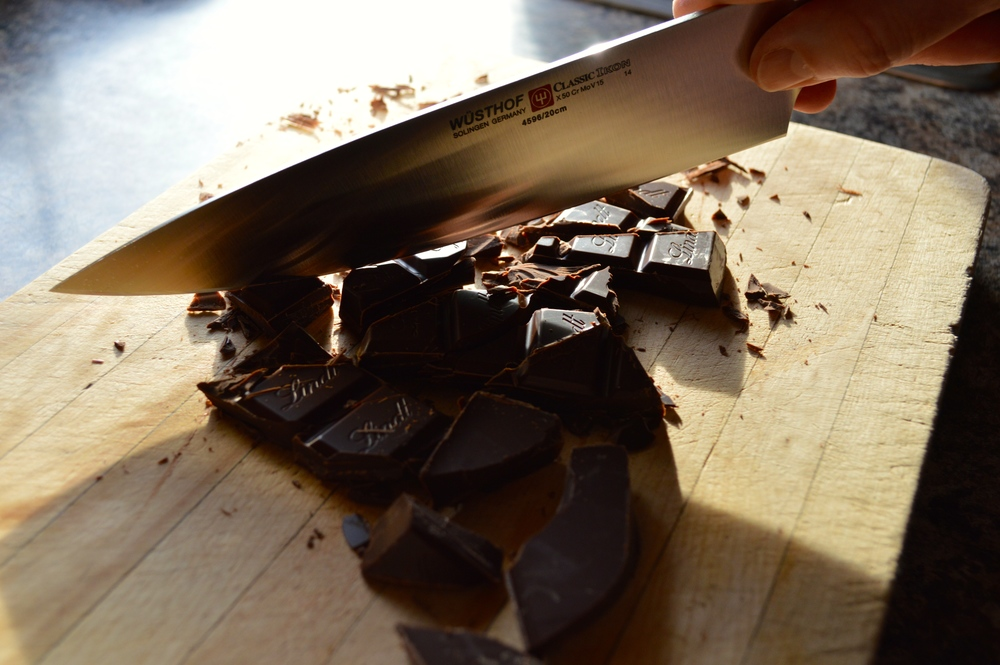 "The WÜSTHOF Classic Ikon 8"" Chef's Knife chops up the dark chocolate."
