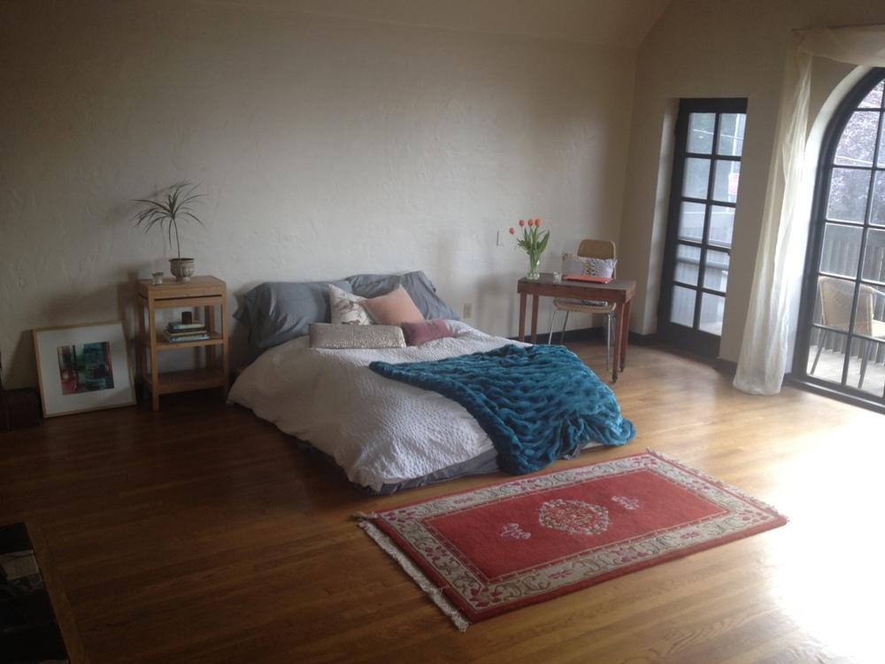 My former living room. Now my writing area, bedroom, living room, yoga and dance studio..