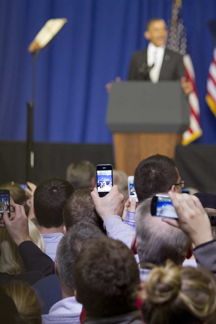 Attendees use cell phones and other electronics to record President Barack Obama as he speaks at the University of Vermont, March 30, 2012. Obama was the first sitting president to visit the state of Vermont since 1994.