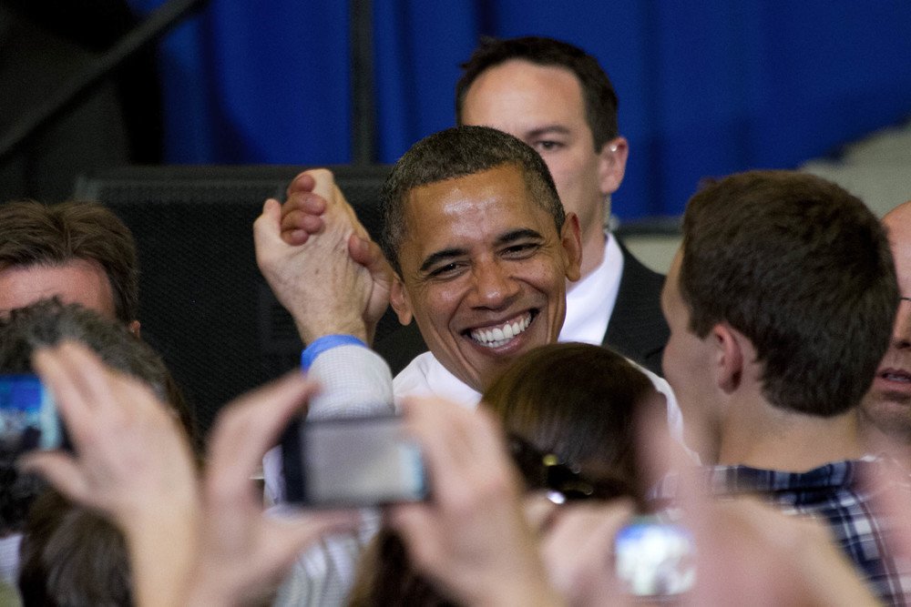 President Barack Obama shakes hands of attendees after hespoke to the University of Vermont, March 30, 2012. Student tickets were $44 for the event in an attempt for increased student attendance.