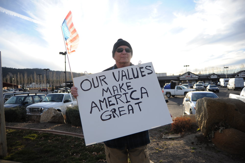 Lew Warden participates in the weekly protest on the side of Big Bear Boulevard Nov. 30, 2017. Warden said he tries to emphasis positivity in his protest signs.