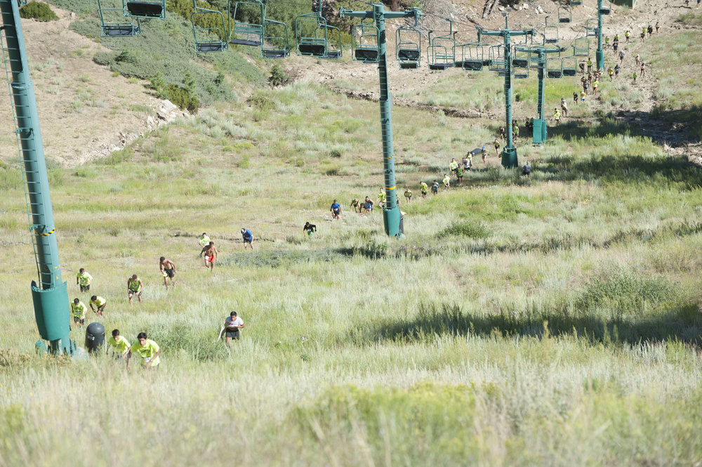 "Racers follow each other as they hike up ""The Wall"" at Snow Summit ski resort July 29, 2017. The first-ever ""Conquer the Wall"" race had 167 runners compete."