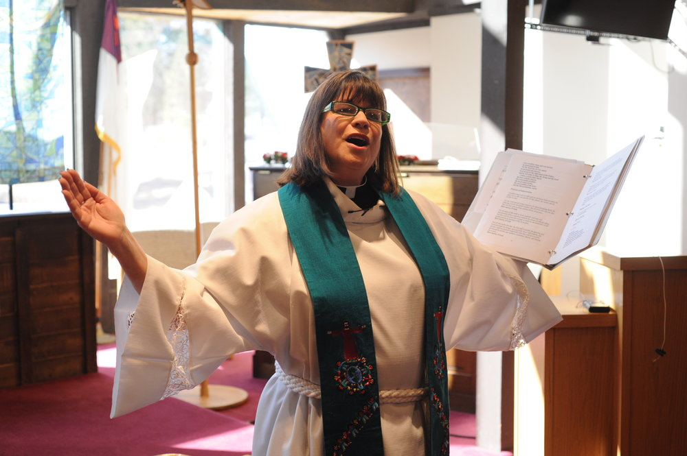 Pastor Dianne Finnecy greets members Feb. 4 during a Spirit of Peace Lutheran Church service.
