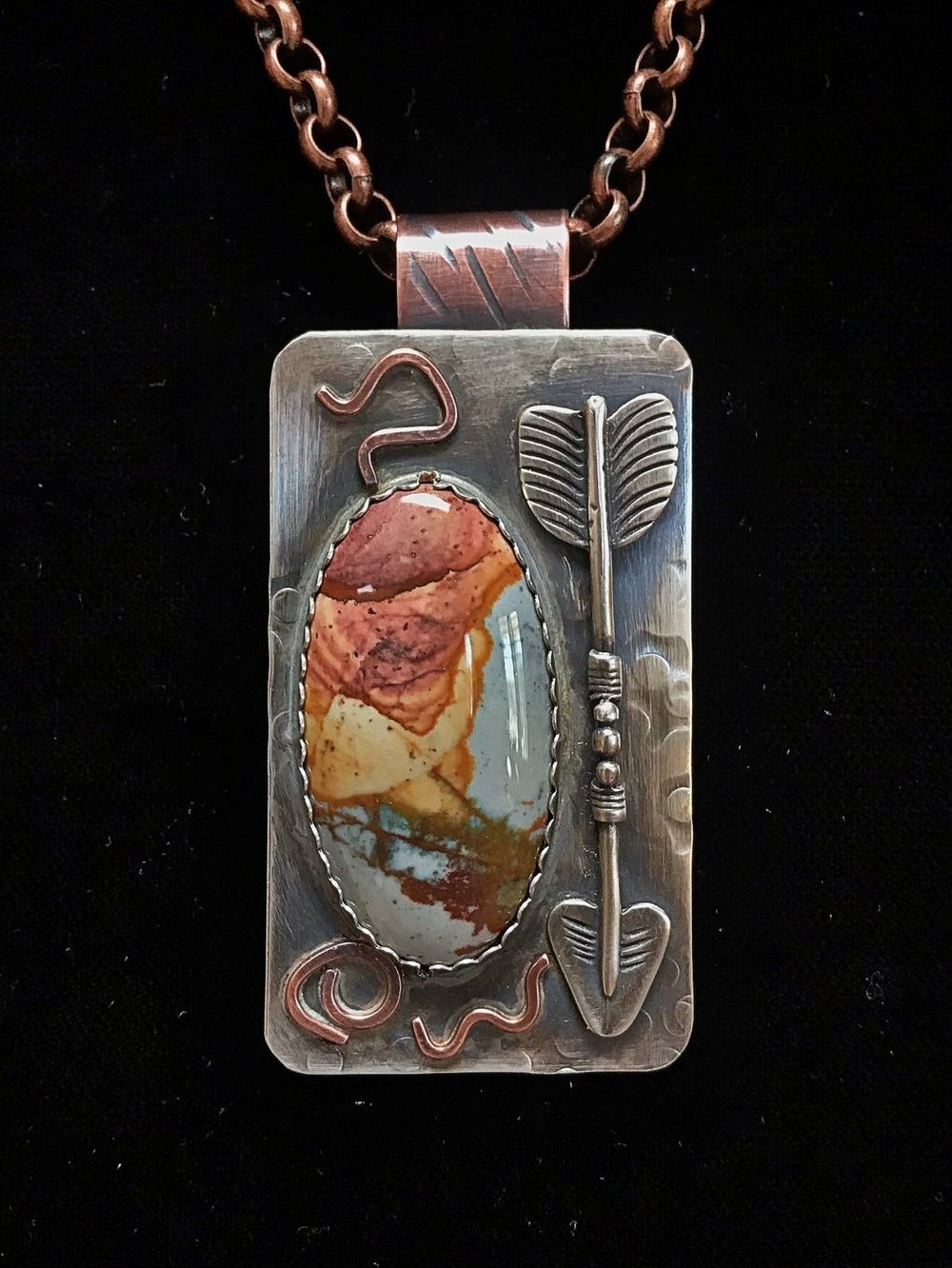 "- ""Thinking Of What Used To Be"" Pendant. Owyhee Jasper! Originating near the border of Oregon and Idaho, this stone was cut by Jay Spence, WA and set into sterling silver with sterling silver & copper accents. Some consider this stone excellent for financial success and/or enhancing the intellectual and attentiveness of the wearer. Paddy Hitt Barrett says: I love this. I'll show my husband! Judy Kaiser says: I purchased a similar one from you. Wore it yesterday💕"