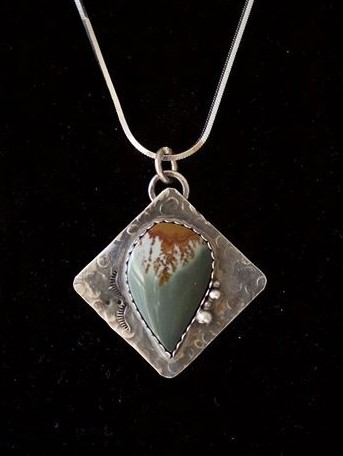 """Owyhee Desert Summer"" Pendant.  Owyhee Jasper!  A favorite stone shaped by a favorite master stonecutter, Jeff Hansen, OR. Comments from followers include Candace Gates:   Truly beautiful, my pick so for, they are all beautiful thou!     Denise Jansky:   Looks liked brown lava flowing across white sand in to a blue/green ocean .  Mike Grant:   Beautiful, I love your jewelry!     Joy L Schmidgall Hagerty:   Very pretty love Jasper."