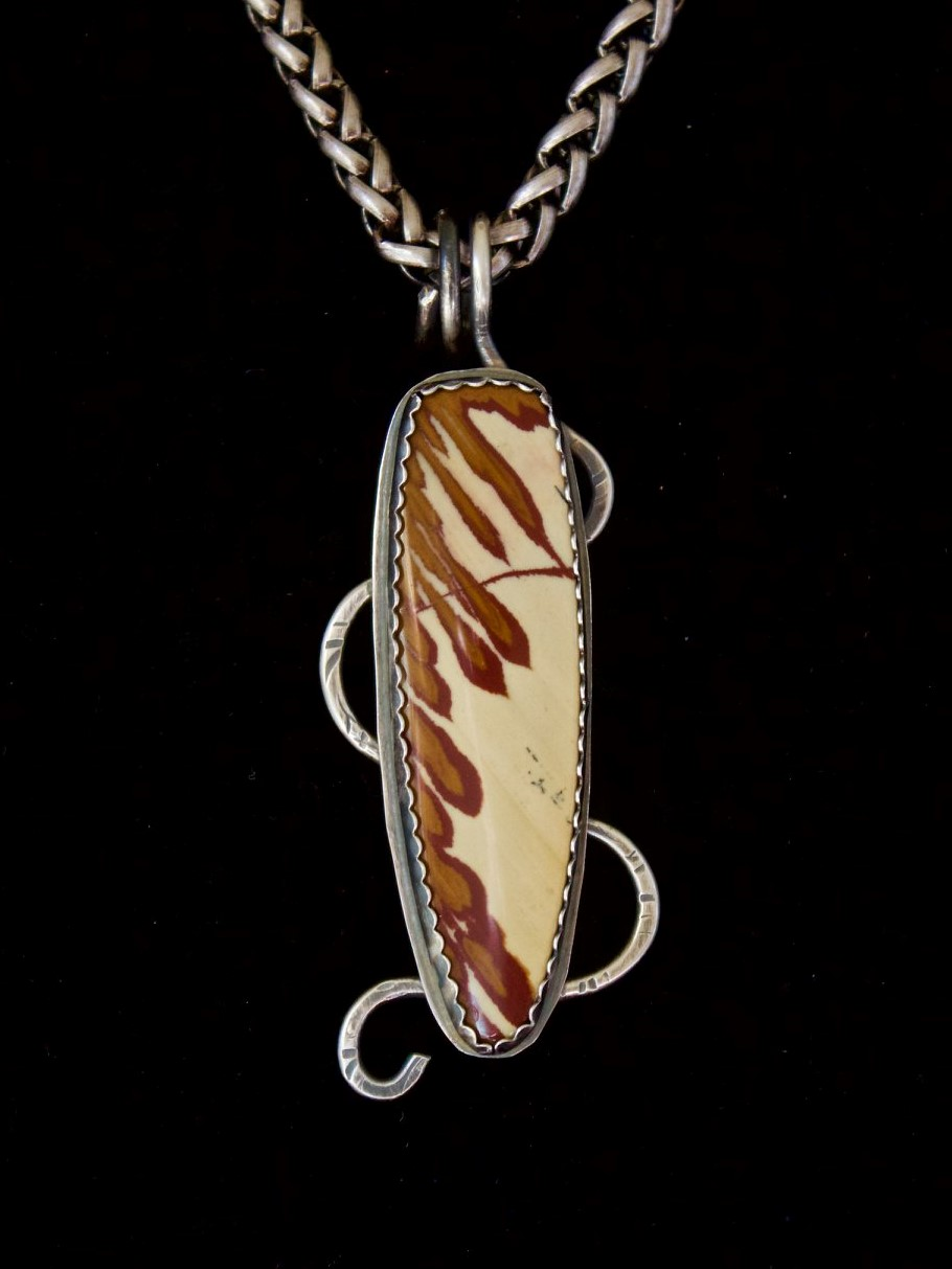 "Owyee Jasper!  This pendant is called ""Doorway To The Owyhee Desert"" and was cut by master lapidarist Keith Horst, AZ. Sylvia Belle Drury says:   Outstanding work!   and others offer their visual description. Jo E. Caruso   That's beautiful. Looks like feathers   and from Paul Smith:   Wow, beautiful stone. Like chocolate syrup drizzling down some vanilla ice cream."