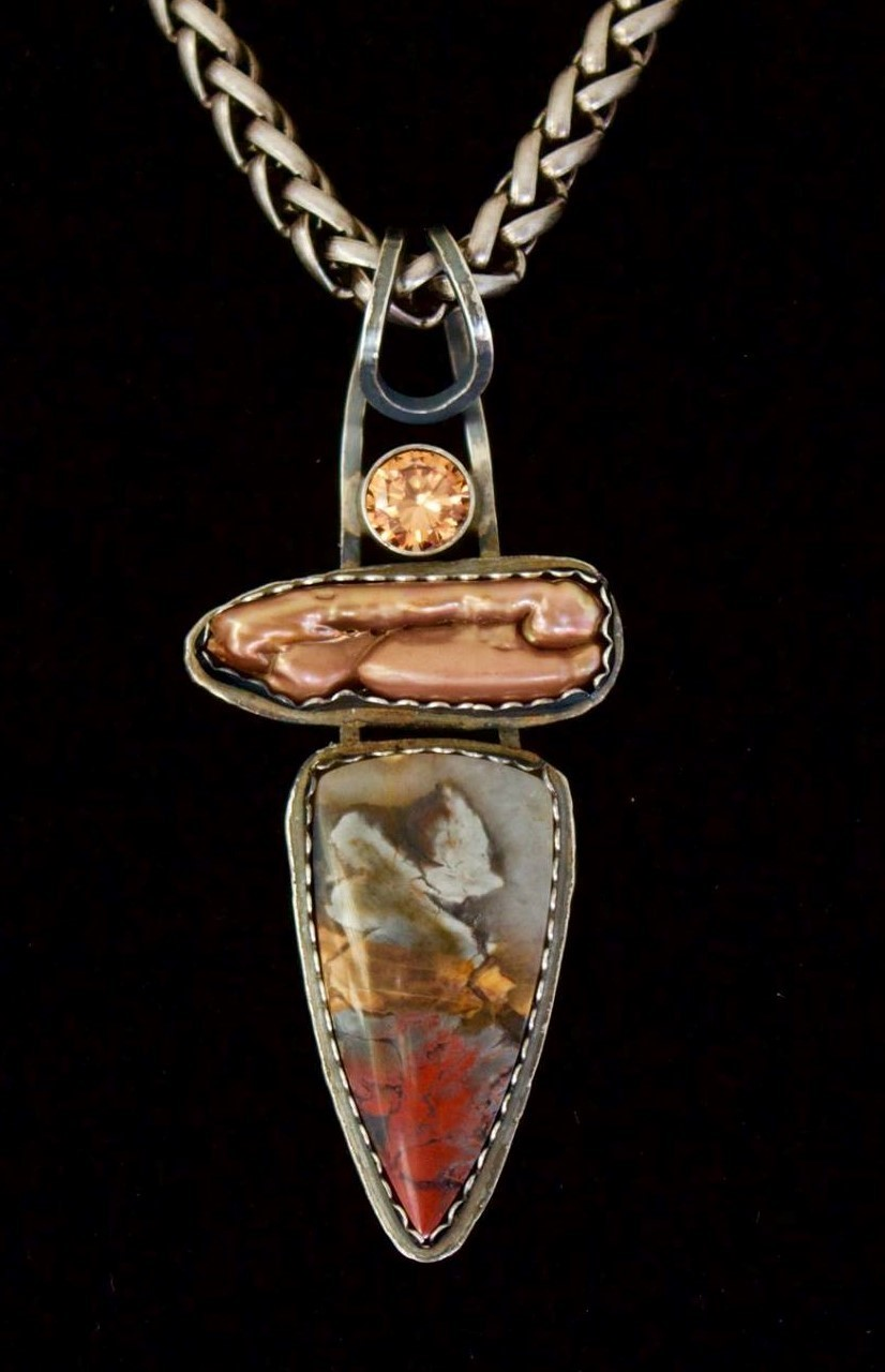"- ""Forbidden Dreams"" Pendant. Tabu Tabu Jasper! Very different Jasper cut by Jeff Hansen, OR and accented with a freshwater pear and topaz faceted stone. Commenting are: Tracy Spencer: Very nice. Very different. Cyndi Dan Wolke: Beautiful composition❤ Frank Saracino: Love Stuff like this AWSOMEINGLY BEAUTIFUL"