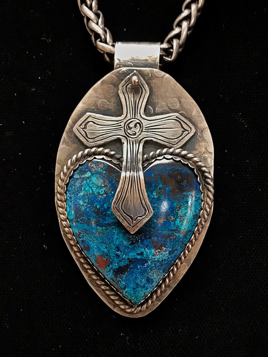 "- A gorgeous Chrysocolla stone, cut by Russ Kaniuth, CA and set in 20 gauge sterling silver with sterling silver accents is the centerpiece of my ""Faith and Circumstances of the Heart"