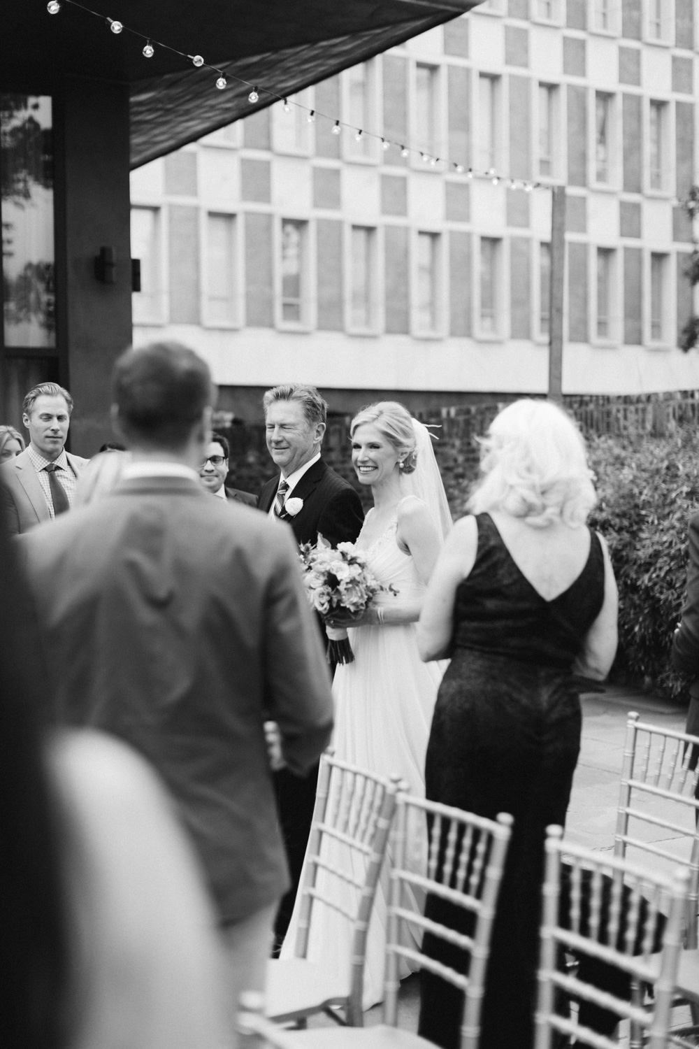 Meredith and her father walking down the isle. Wedding at The Dewberry, downtown Charleston