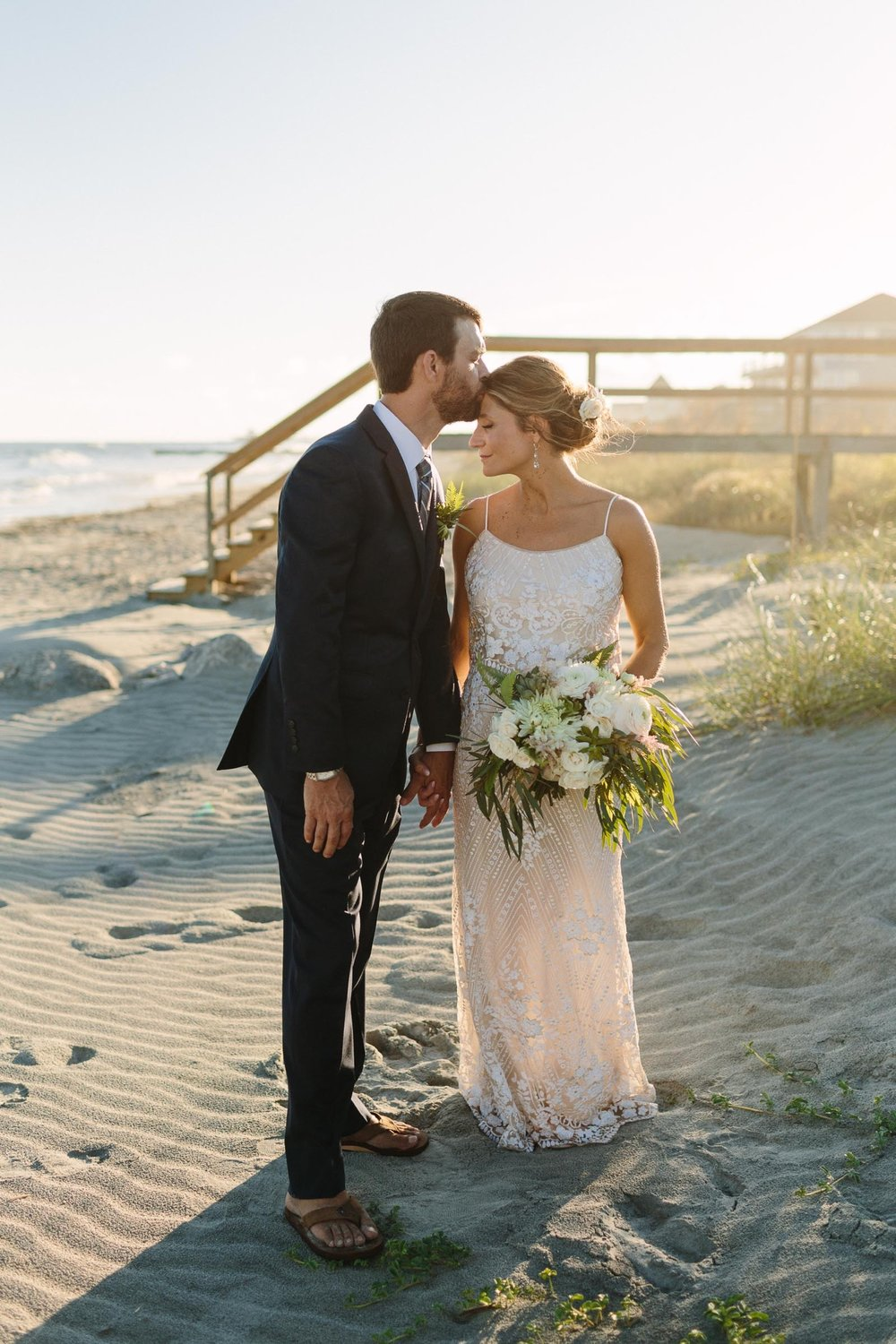 natalie_brooks-43_folly_beach_Wedding_Weddings_Charleston_CHS_Holy_City_brides_bride_Groom_House_Pour_flowers_intimate_Elopement_1500.jpg