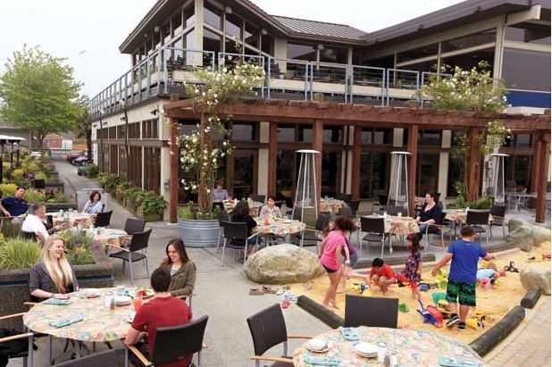 The casual café and nearby sandpit at Anthony's HomePort Edmonds and Beach Café