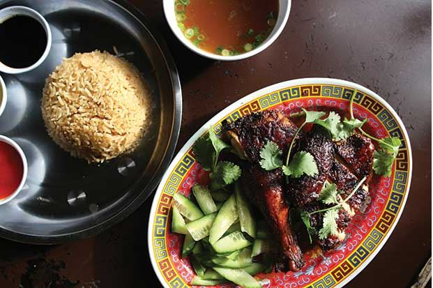 Nasi Ayam: roasted bone-in chicken, rice cooked with chicken stock, cucumber, green onion, cilantro, chili lime sambal, soy with sesame and fresh pounded ginger, from Kedai Makan on Capitol Hill