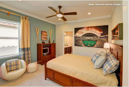 The Bats Serve As A Focal Point In Baseball Themed Bedroom Complete With Glove And Two Framed Images