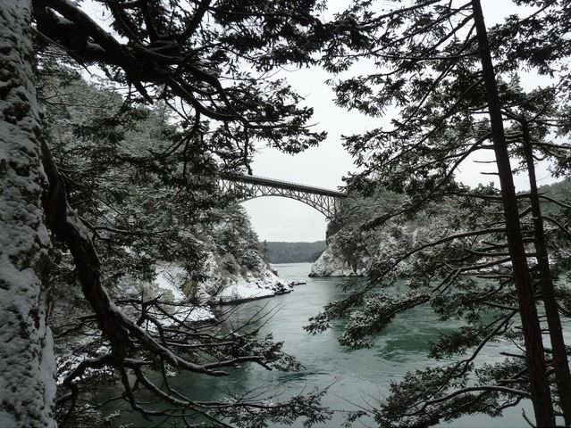 A rare picture of Deception Pass Bridge spanning Fidalgo and Whidbey Island and surrounding area covered in snow.