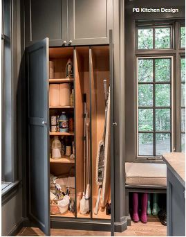 This Broom Closet Offers Order Via Vertical Dividers That Separate The  Ironing Board From The Broom And Mop.