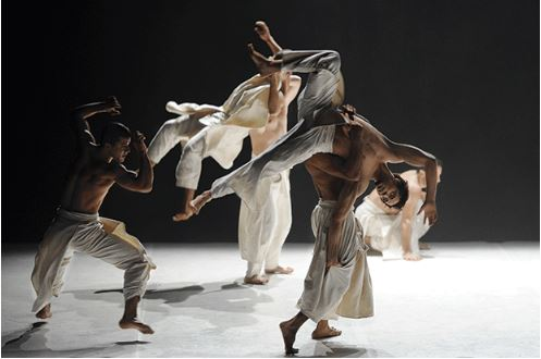 """Image by Nathalie-Sternalski The Washington Post called What the Day Owes to the Night a """"stunning fusion of acrobatics, gymnastics, b-boying, modern dance and ballet."""""""