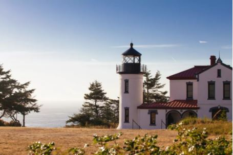 The Admiralty Head Lighthouse at Fort Casey, backdropped by a western view of the Puget Sound IMAGE:ALISON KLEIN