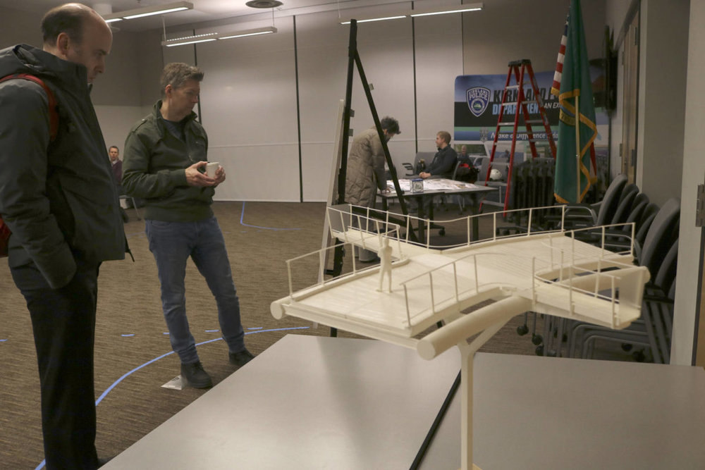 """Community members review the current designs of the Totem Lake Connector Bridge and the proposed """"plank"""" overlook that will offer a unique view of Totem Lake. Kailan Manandic, Kirkland Reporter"""